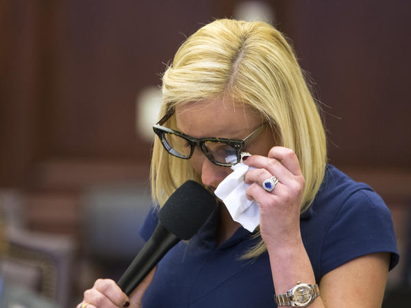 Florida Sen. Lauren Book wipes her eyes during the debate over gun control at the Capitol in Tallahassee.