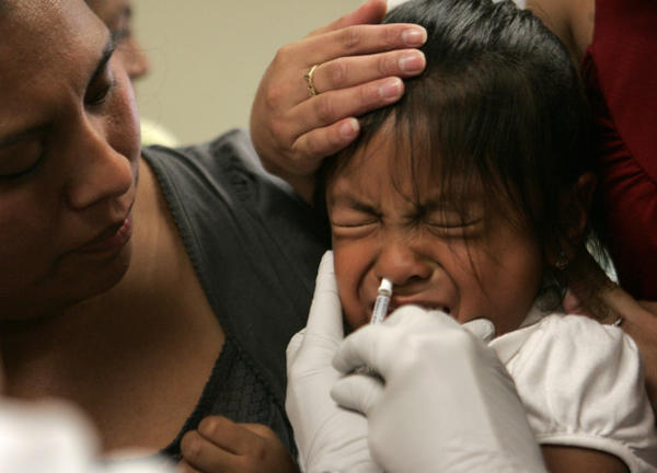 <p>Amparo Martinez, left, watches as her daughter, Sorayo Martinez, 4, is given a dose of swine flu vaccine in Oregon City, Oregon, Tuesday, Oct. 6, 2009.</p>