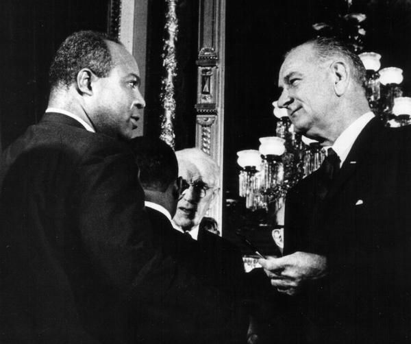 President Lyndon B. Johnson presents one of the pens used to sign the Voting Rights Act of 1965 to James Farmer, Director of the Congress of Racial Equality on August 6, 1965.