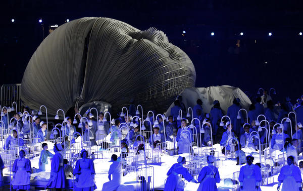 A sequence representing Britain's National Health Service, including dozens of NHS workers themselves, is performed during the opening ceremony at the 2012 Summer Olympics in London.