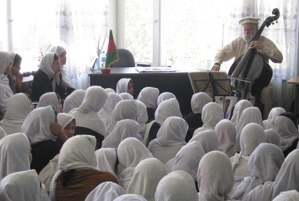 Dobbs performing at a school for girls in Afghanistan.