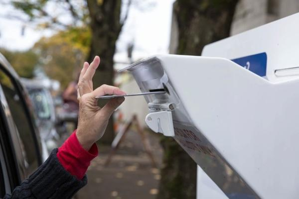 <p>A voter drops off a ballot at a Multnomah County dropbox in November 2016.</p>