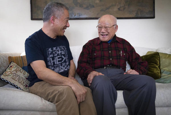 <p>Patrick Yamashita, left, laughs with his father Jerry while posing for a portrait on Friday, Feb. 9, 2018, at his home in Seattle.</p>