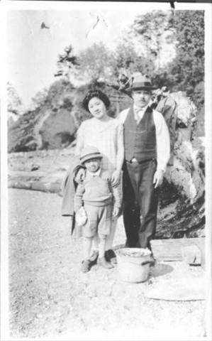 <p>Jerry Yamashita stands with his mother, Masako, and father, Masahide, in 1927.</p>