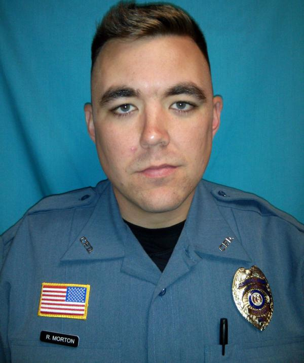This photo released by the Clinton Police Department shows Officer Christopher Ryan Morton, who was fatally shot while trying to apprehend a suspect after responding to a 911 call at a Missouri residence Tuesday night. Two officers were wounded.