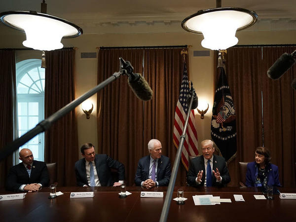 With the cameras rolling, President Trump meets with lawmakers to discuss school and community safety on Feb. 28.