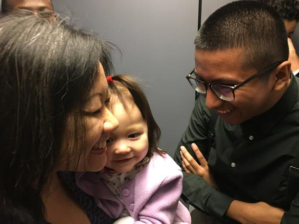 Del. Tran gets help from her staff, including Rodrigo Velazquez, who says he enjoys playing with Tran's baby when the delegate is busy.
