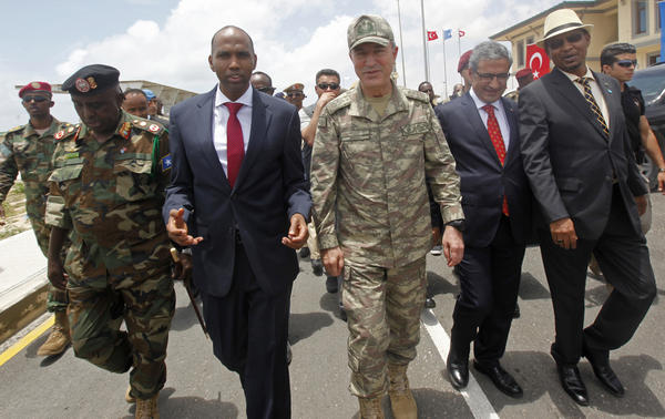 Turkish Armed Forces Chief of Staff Gen. Hulusi Akar, center, and Somali Prime Minister Hassan Ali Khayre, second left, tour a new Turkey-Somali military training center in Mogadishu, Somalia, on Sept. 30.