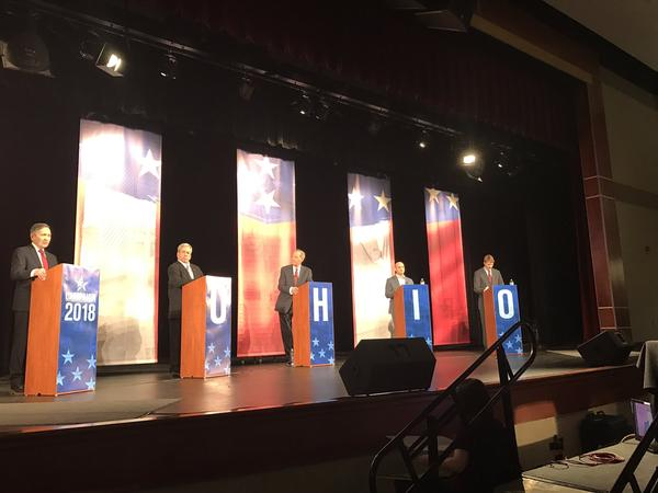 The four Democratic candidates shared the stage with Jerry Anderson of WTOL-TV in Toledo (center).