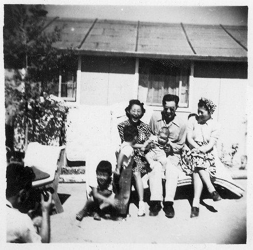 Mike Wada (center) sits outside the barracks with friends from Los Angeles.