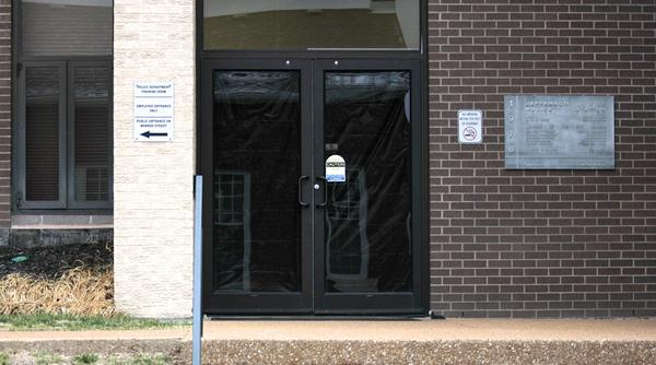 Black-out sheets cover the glass doors at the back entrance of the Jefferson City Police Dept., where the House committee investigating Greitens' indictment met Wednesday to hear testimony from witnesses.
