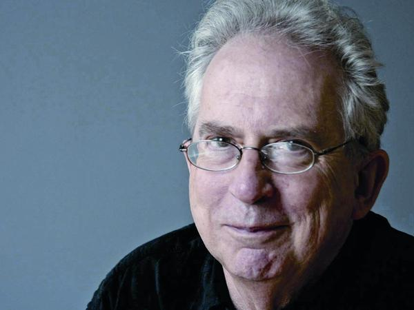 """Australian author Peter Carey says he """"couldn't not write"""" about his country's dark history of racism."""