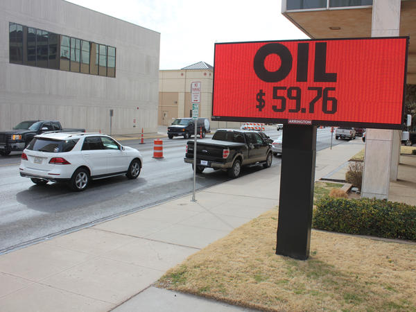 An LED light flashes the going price of a barrel of oil in downtown Midland, Texas. U.S. production is at record levels even though the price of oil is not nearly as high as during the last boom.
