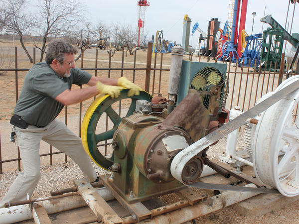At the Permian Basin Petroleum Museum, facilities manager James White demonstrates how a 'Johnny Popper' engine used to power oil pumpjacks.