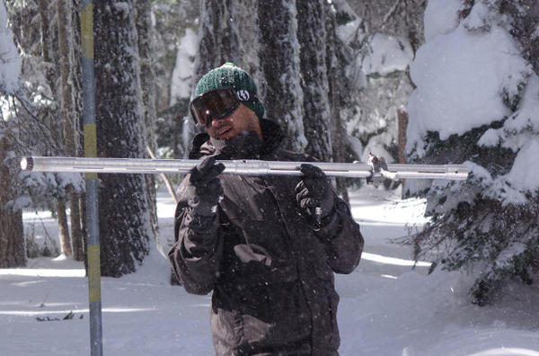 <p>Jackson County Watermaster Shavon Haynes prepares to weigh a snow core sample in Southern Oregon.</p>