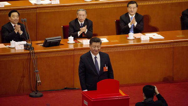 Xi Jinping stands after casting his ballot during a vote to repeal presidential term limits during a session of the National People's Congress at the Great Hall of the People in Beijing on Sunday.