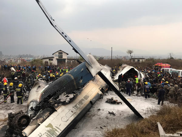 Rescue workers rushed to the scene of a US-Bangla Airlines jetliner that crashed at an airport in Kathmandu, Nepal, on Monday.