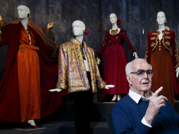 Hubert de Givenchy poses at the Gemeentemuseum in the Netherlands in 2016 during a retrospective of his work.
