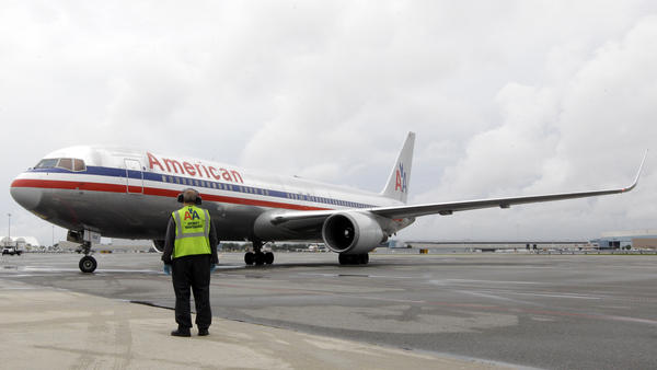 An American Airlines taxis in 2012. According to prosecutors, beginning in that year, the brother-son duo targeted American Airlines employees who worked the tarmac, telling them they had sustained hearing loss and needed hearing aids.