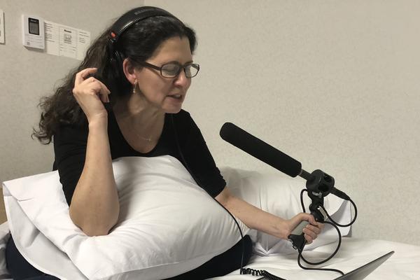 Melissa Block records audio in her room.