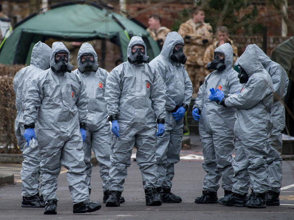 Military personnel wearing protective suits investigate the poisoning of Sergei Skripal in Salisbury, England. Skripal and his daughter, Yulia, remain critically ill.