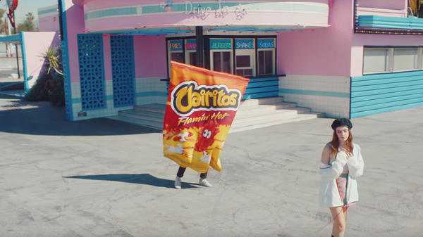 "A still from Clairo's ""Flaming Hot Cheetos"" video."