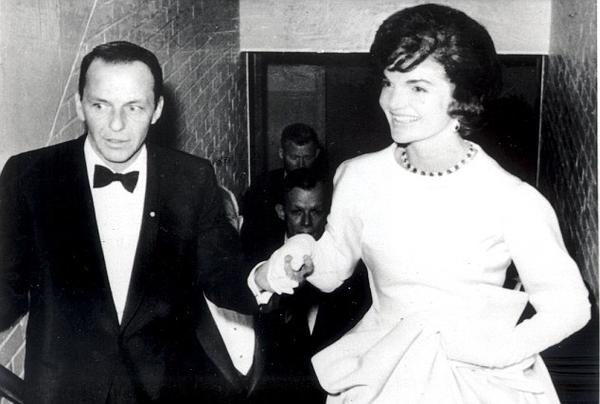 Frank Sinatra escorting Jackie Kennedy to her box at the National Guard Armory, Jan 1961