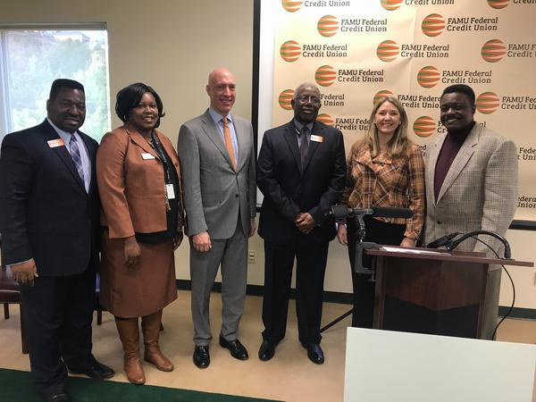 Joined by local leaders, FAMU Federal Credit Union Ernest Allen (3rd from right) and Florida Department of Economic Opportunity Executive Director Cissy Proctor (2nd from right) announced a new partnership through the DEO's Black Business Loan Program.
