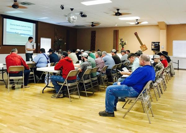 Farmers attend a dicamba training session on Feb. 20 in Cadiz, Kentucky.
