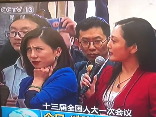 A screenshot of Liang Xiangyi, a financial news reporter, who was so disgusted by a fellow reporter's softball question to a government official at this week's National People's Congress that she was caught on live television rolling her eyes. The moment went viral.