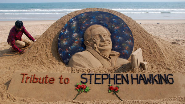 Sand artist Sudarsan Patnaik puts final touches on a sculpture in honor of Stephen Hawking at Puri Beach near Bhubaneswar, India, on Wednesday. Hawking, whose mental genius and physical disability made him a household name and inspiration across the globe, died on Wednesday at age 76.