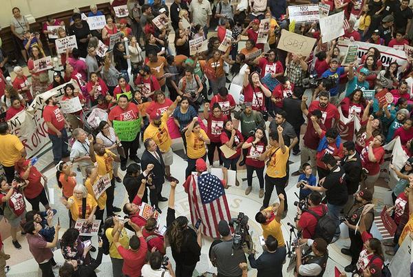 Demonstrators rally in the Capitol Rotunda against Senate Bill 4 on May 29.