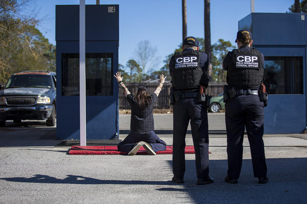 At the federal law enforcement training center in Brunswick, Georgia, U.S. Customs and Border Protection officer trainees conduct a border crossing drill. (Jesse Costa/WBUR)