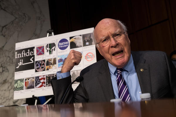 With examples of Russian-created Facebook pages behind him, Sen. Patrick Leahy, D-Vt., questions witnesses during a 2017 Senate hearing on Russian-backed ads on social media in the 2016 election. Now, the Federal Election Commission is looking into increasing disclosure requirements for online ads.