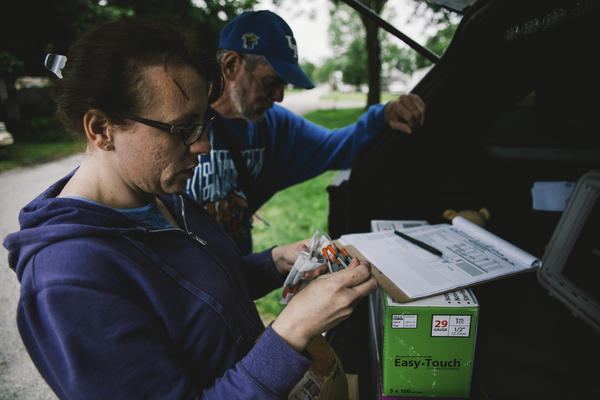 The Scott County Health Department's Brittany Combs makes a weekly stop with the county's syringe exchange program's mobile unit in Austin, Indiana. A state law means such programs must be renewed every two years at the most.