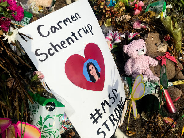 A makeshift shrine for Carmen Schentrup stands outside Marjory Stoneman Douglas High School. Hers is one of 17 shrines to the victims of the Parkland shooting.