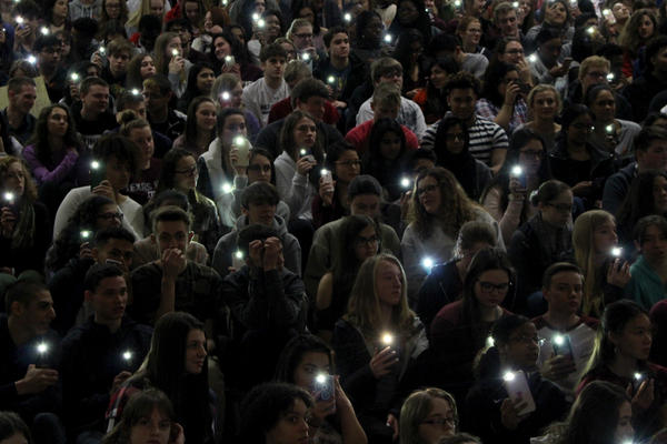 Students hold their lighted cellphones at a rally at Parkland High School outside Allentown, Pa., on Wednesday.