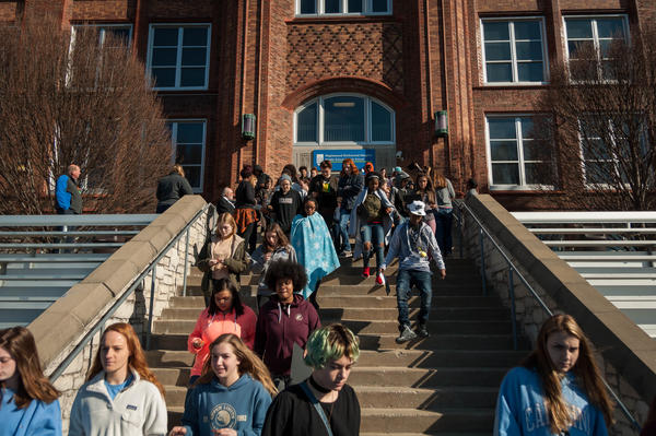 Students in Maplewood Richmond Heights exit school to demonstrate for as part of a national school walkout.