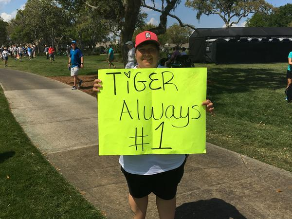 "Stephanie Valdez of Orlando, Fla., says she's been a Tiger Woods fan since 1996. She followed Woods his entire final round Sunday. Valdez is ""glad he turned his life around. He's back in the game."""