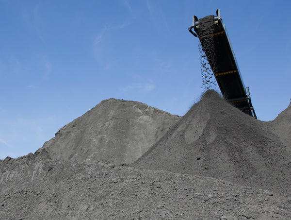 Coal ash waste in piles before being shipped to a landfill or pond.