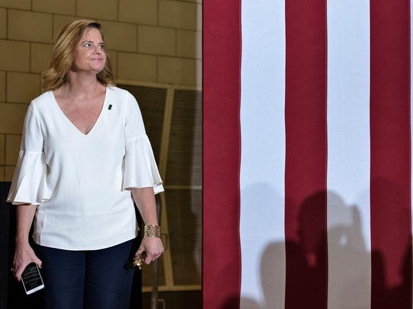 Jennifer Palmieri waits for  Hillary Clinton to speak during a rally in North Carolina in September, 2016.