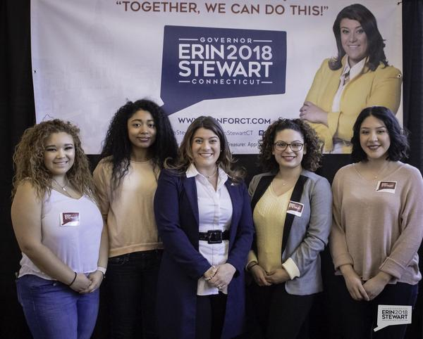 New Britain Mayor Erin Stewart, center, stands next to students from Central Connecticut State University at Monday's announcement.