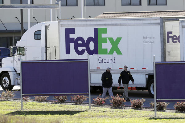 Agents from the Bureau of Alcohol, Tobacco, Firearms and Explosives join the investigation at a FedEx distribution center in Schertz, Texas, where a package exploded Tuesday. Authorities believe the incident is linked to the recent string of Austin bombings.