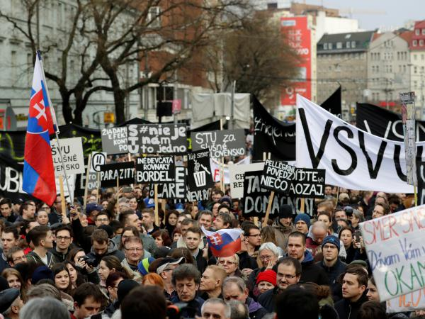 Demonstrators attend a protest rally in reaction to the murder of Slovak investigative reporter Ján Kuciak and his fiancée Martina Kusnírová, in Bratislava on Friday.