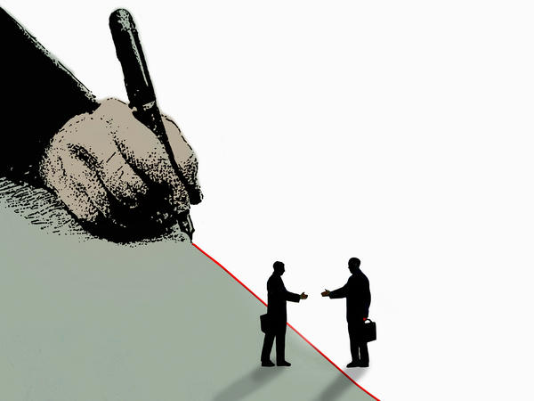 Two businessmen reach to shake hands across a red line.