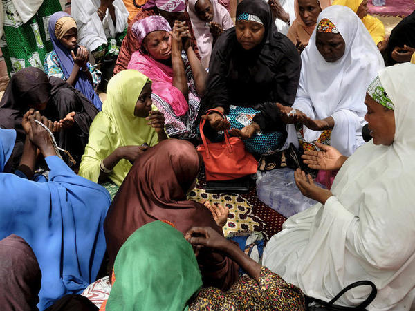 Rebecca Sharibu (center in pink shawl) prays in Dapchi earlier this month. Her 15-year-old daughter, Leah, is said to be the only student remaining in captivity after Boko Haram released 104 of her schoolmates on Wednesday. Leah has reportedly refused to convert from Christianity to Islam.