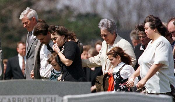 Family members of Paige Ann Herring walk to her gravesite on March 27, 1998. Mary Hollis Inboden, who was Paige's best friend, says one of the worst moments of her life was when Paige's mother frantically opened the gym office door and screamed her daughter's name.