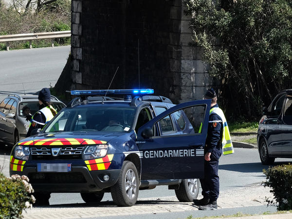A roadblock is set up in Trebes. The attack there may be linked to an earlier incident in the nearby city of Carcassonne.