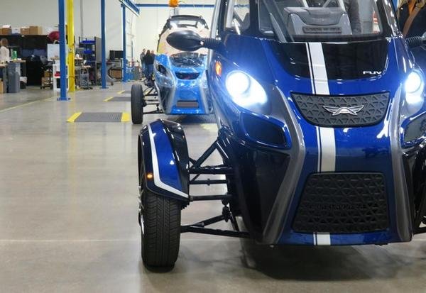 <p>A row of Acrimoto's distinctive three-wheeled electric vehicles sit in its Eugene, Ore. factory.</p>