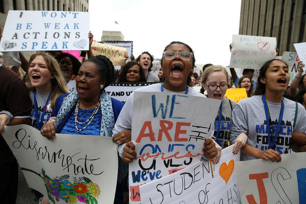 """U.S. Rep. Sheila Jackson Lee (center left) and student organizers lead the """"March for Our Lives"""" in downtown Houston."""